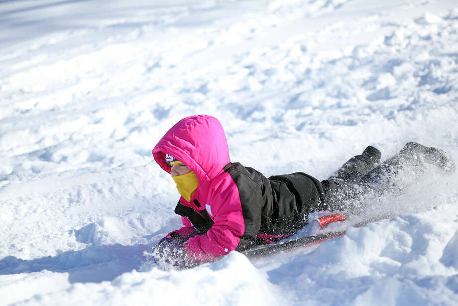 Ricki Bronner, 4, goes sledding at Kendall School in Norwalk after Winter Storm Jonas Sunday morning. Hour Photo / Danielle Calloway