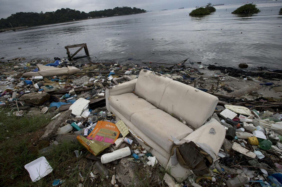 "FILE - In this June 1, 2015 file photo, a discarded sofa litters the shore of Guanabara Bay in Rio de Janeiro, Brazil. About 1,600 athletes will compete in Rio during the 2016 Summer Olympics. Hundreds more will be involved during the subsequent Paralympics. Experts say athletes will be competing in the viral equivalent of raw sewage with exposure to dangerous health risks almost certain. Many sailors have described the conditions as ""sailing in a toilet"" or an ""open sewer."" (AP Photo/Silvia Izquierdo, File)"