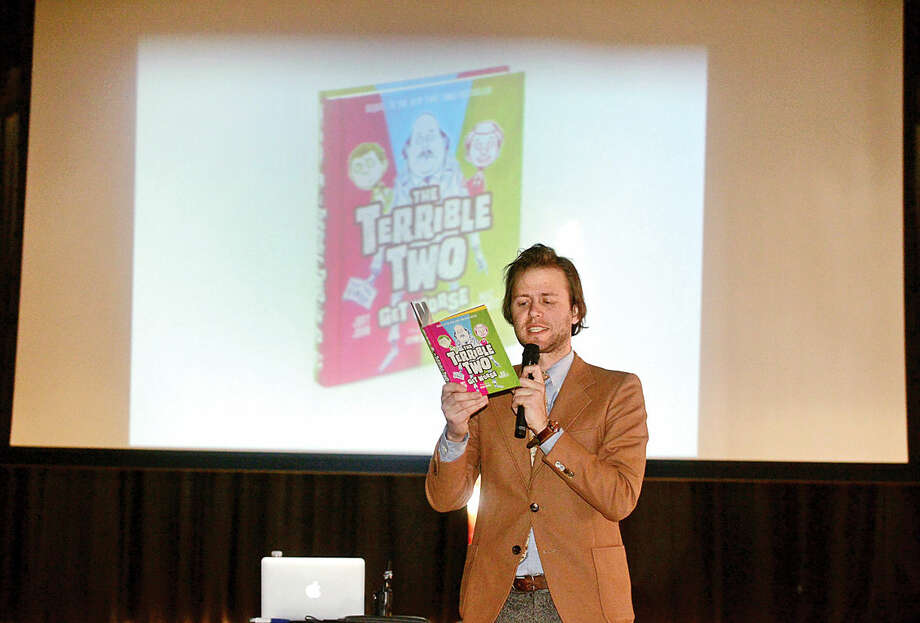 Hour photo / Erik Trautmann Mac Barnett reads to Silvermine Elementary School students from the latest book he co-authored with Jory John, The Terrible Two Get Worse, Wednesday afternoon. This is a follow up to their original book, The Terrible Two.