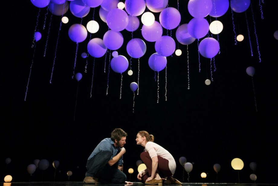 "This publicity photo released by Boneau/Bryan-Brown shows, from left, Jake Gyllenhaal and Ruth Wilson, in a scene from Nick Payne's ""Constellations,"" currently performing on Broadway at the Samuel J. Friedman Theatre in New York. (AP Photo/Boneau/Bryan-Brown, Joan Marcus)"