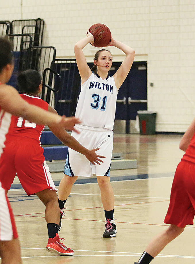 Wilton's #31, Christina Holmgren, makes a pass during a home game against Norwich Free Academy Monday evening.