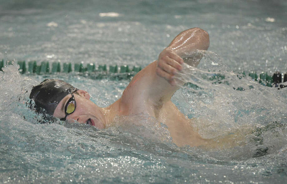 Hour photo/Alex von KleydorffNorwalk's Anthony Dell'Isola wins the 500 freestyle race during Wednesday's meet against Westhill-Stamford.