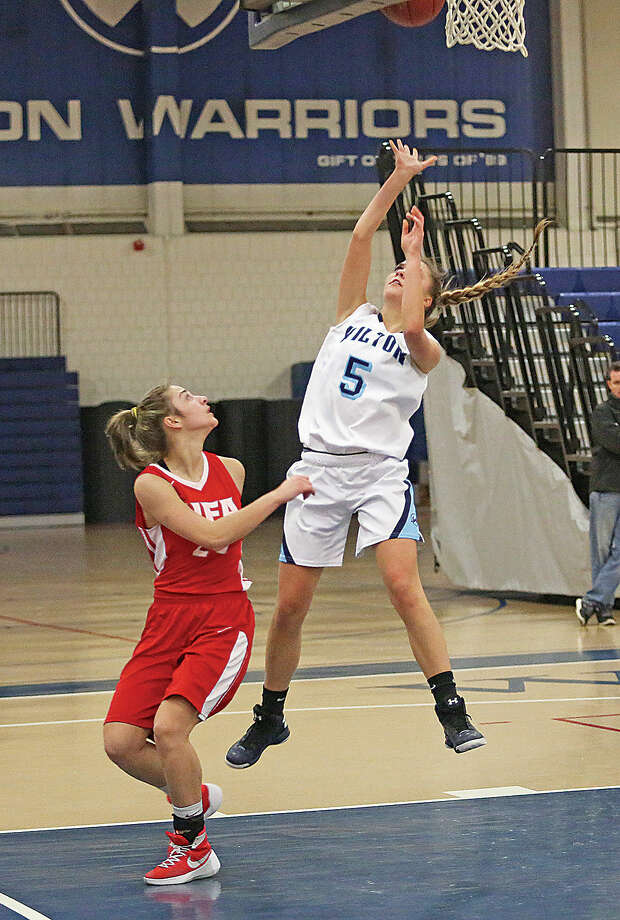 Wilton's #5, Karen Brosko, takes a shot during a home game against Norwich Free Academy Monday evening.