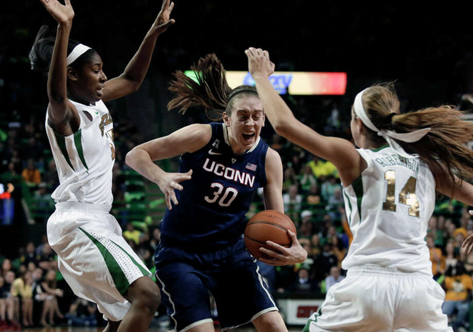 Baylor center Khadijiah Cave, left, and guard Makenzie Robertson (14) attempt to stop a drive to the basket by Connecticut's Breanna Stewart (30) in the first half of an NCAA college basketball game, Monday, Jan. 13, 2014, in Waco, Texas. (AP Photo/Tony Gutierrez) / AP
