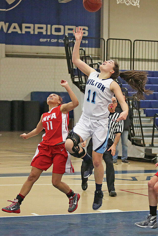 Wilton's #11, Sarah Fitzgerald, takes a shot during a home game against Norwich Free Academy Monday evening.