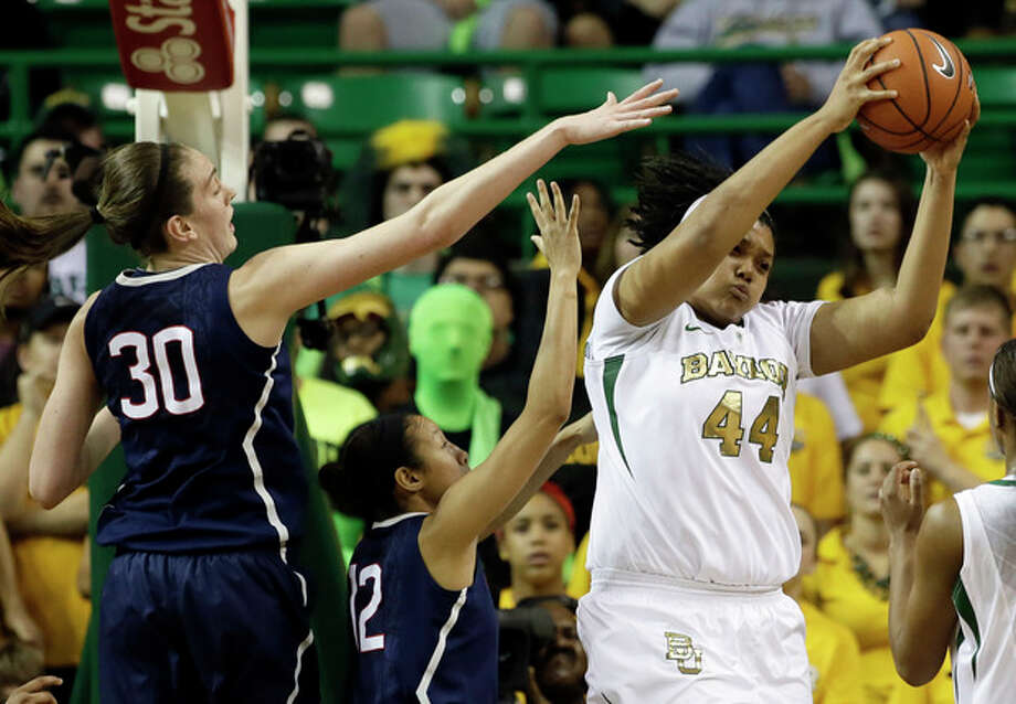 Connecticut's Breanna Stewart (30) and Saniya Chong, center, compete for a rebound against Baylor's Kristina Higgins (44) in the first half of an NCAA college basketball game, Monday, Jan. 13, 2014, in Waco, Texas. (AP Photo/Tony Gutierrez) / AP