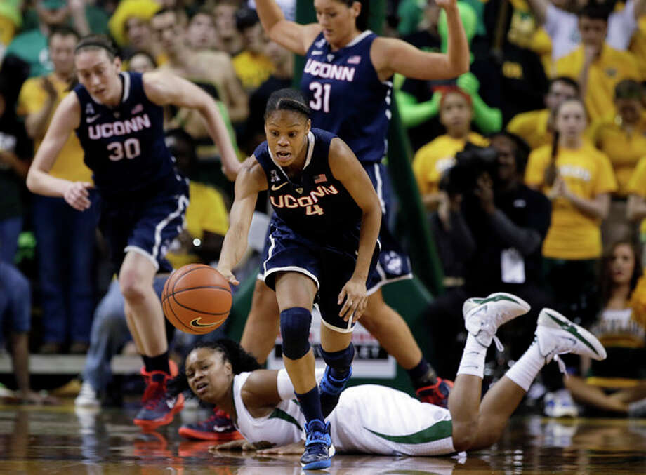 Connecticut guard Moriah Jefferson (4) comes away with a loose ball as Baylor guard Odyssey Sims, bottom, watches in the first half of an NCAA college basketball game, Monday, Jan. 13, 2014, in Waco, Texas. (AP Photo/Tony Gutierrez) / AP