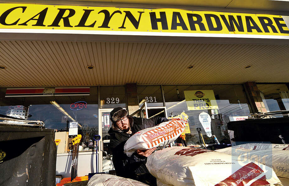 Hour photo / Erik Trautmann Cutomers at Carlyn Hardware, including Sophie Camie Assocuiates employee Robert Bergeron, stock up on supplies for the Snowstorm Jonas which approaches the Northeast Friday.