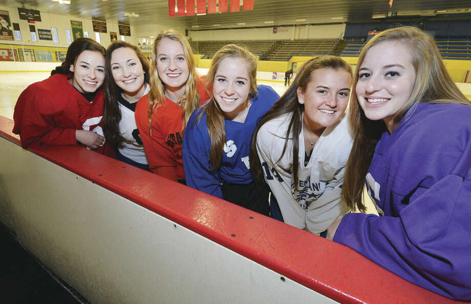 Photo by Alex von KleydorffKey seniors for the Westhill-Stamford-Staples co-op girls hockey team include, from left, Ellie Grafstein, Jessica Mezias, Rachel Benz, Casandra Miolene, with Meg Fay and Claire Mioline.