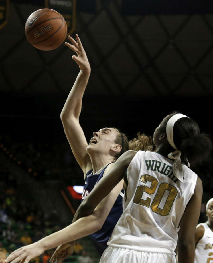 Connecticut's Breanna Stewart, left, fights her way to a shot opportunity against Baylor's Imani Wright (20) in the first half of an NCAA college basketball game, Monday, Jan. 13, 2014, in Waco, Texas. (AP Photo/Tony Gutierrez)
