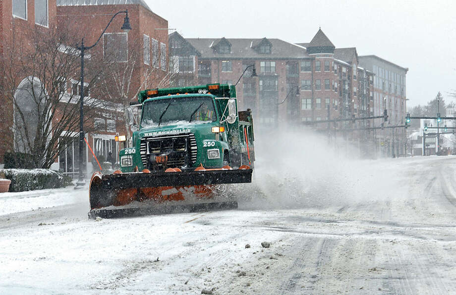 Hour photo / Erik Trautmann DPW trucks in Norwalk cope with Snowstorm Jonas as it moves through the area Saturday.