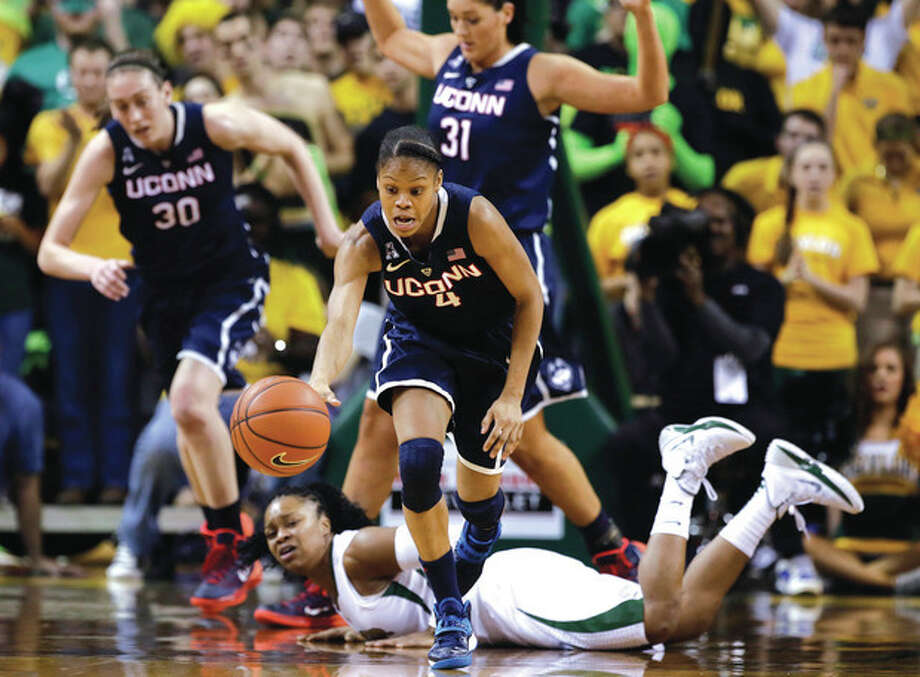 AP photoUConn guard Moriah Jefferson (4) comes away with a loose ball as Baylor guard Odyssey Sims, bottom, watches during Monday night's game between the last two national champions. UConn won, 66-55. / AP