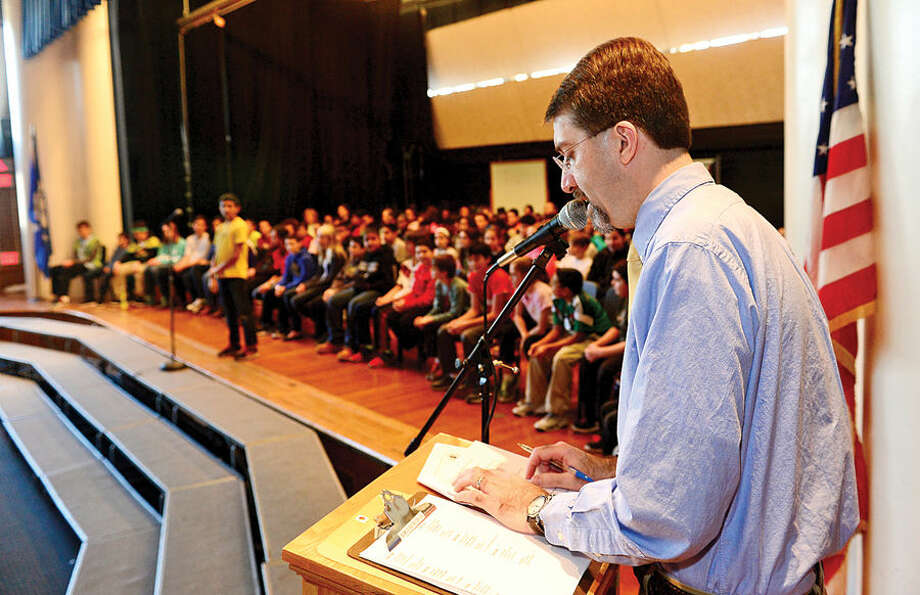 Hour photo / Erik Trautmann Nathan Hale Middle School teacher Dr Dave Gibson asks questions during the school's The National Geographic Geography Bee competition Thursday involving 24 students in grades 6, 7 and 8. The winner of the competition will go on to compete at the state level.