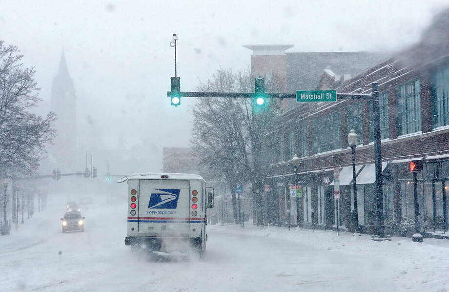 Hour photo / Erik Trautmann Residents and professionals in Norwalk cope with Snowstorm Jonas as it moves through the area Saturday.