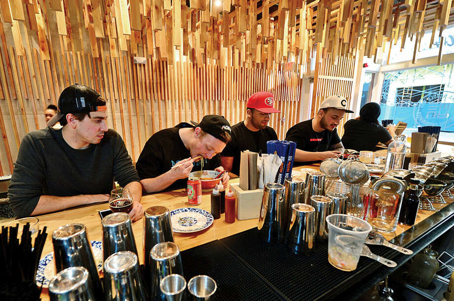 Hour photo / Erik Trautmann Patrons slurp through their meals at the new Mecha noodle bar restaurant in SoNo.