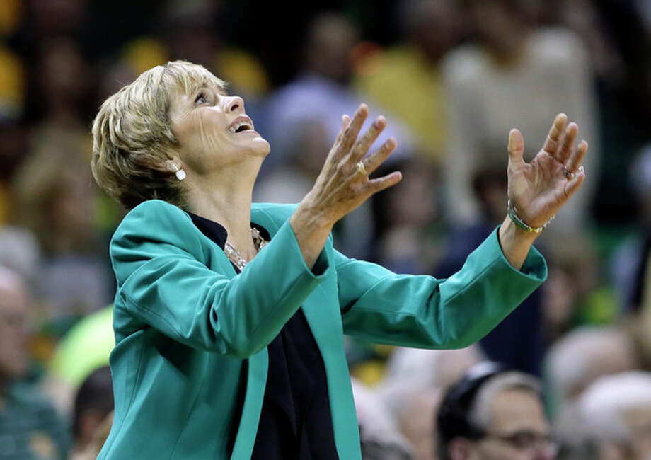 Baylor head coach Kim Mulkey throws her hands up after her team was charged with a foul in the first half of an NCAA college basketball game against Connecticut, Monday, Jan. 13, 2014, in Waco, Texas. (AP Photo/Tony Gutierrez) / AP
