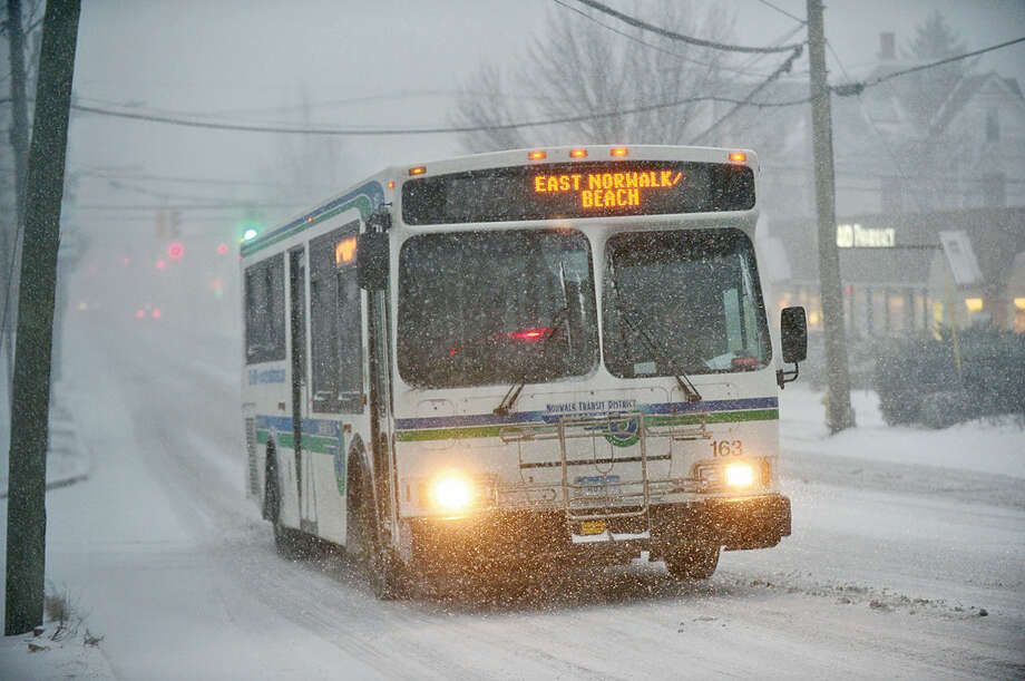 Hour photo / Erik Trautmann Norwalk Transit District has buses running during Snowstorm Jonas as it moves through the area Saturday.