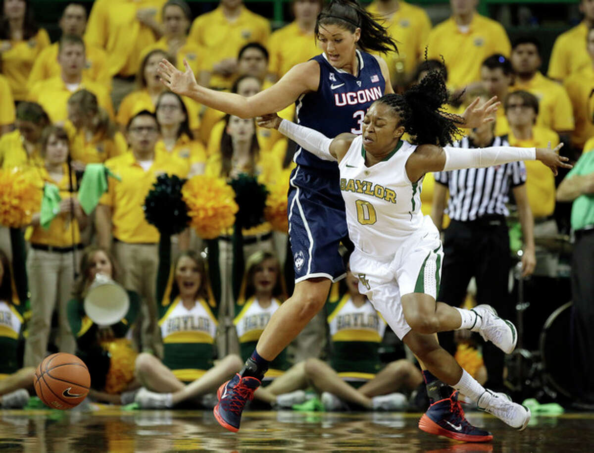 Baylor guard Odyssey Sims (0) loses the ball trying to get around Connecticut's Stefanie Dolson (31) in the first half of an NCAA college basketball game, Monday, Jan. 13, 2014, in Waco, Texas. (AP Photo/Tony Gutierrez)