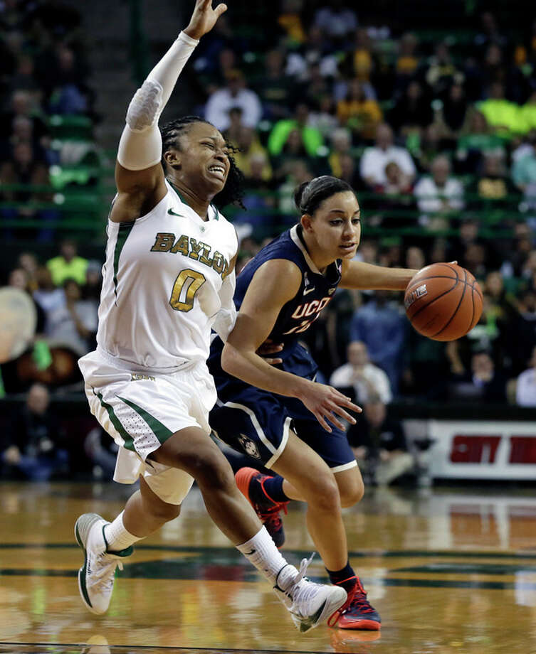 Baylor's Odyssey Sims (0) attempts to cut off a drive around the perimeter by Connecticut's Bria Hartley (14) in the first half of an NCAA basketball game, Monday, Jan. 13, 2014, in Waco, Texas. (AP Photo/Tony Gutierrez) / AP