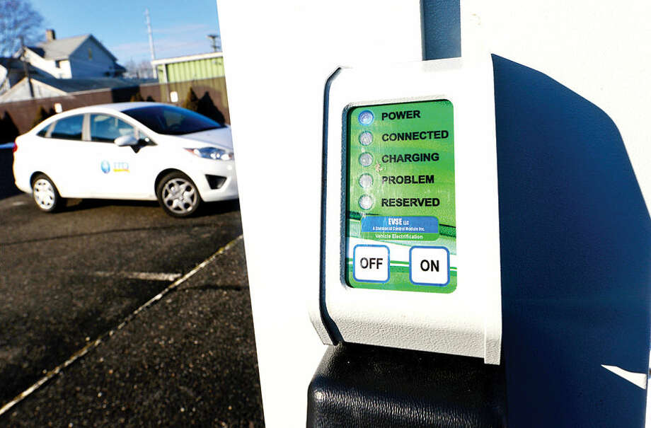 Hour photo / Erik Trautmann Third Taxing District have installed 4 new electric vehicle chargers at East Norwalk Library on Van Zant Street.