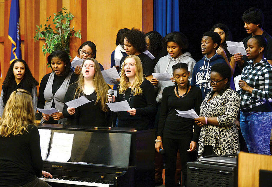 "Hour photo / Erik Trautmann Ponus Ridge Middle School's 8th grade chorus sings during an assembly as part of the school's ""100 Days of No Violence"" agreement Thursday where students pledge to live peacefully over the next 100 days."