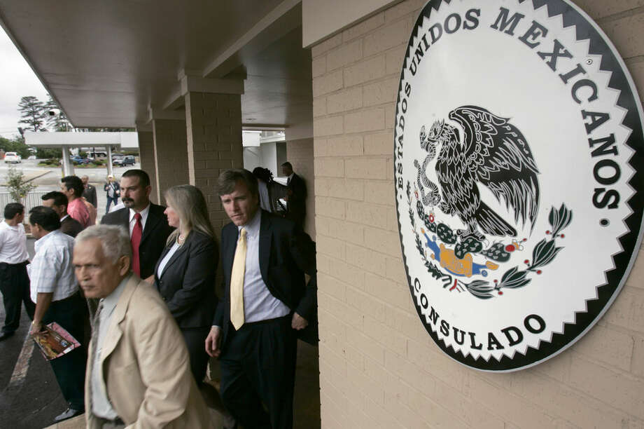 FILE - Visitors walk from the Mexican Consulate in Little Rock, Ark., after the grand opening of the building in this Wednesday, April 25, 2007 file photot. The Mexican government on Thursday Jan. 15, 2015 will start issuing birth certificates to its citizens at consulates in the United States, seeking to make it easier for them to apply for U.S. work permits, driver's licenses and protection from deportation. (AP Photo/Danny Johnston, File)