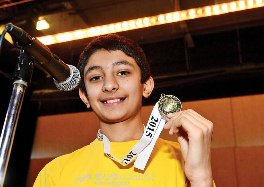 Hour photo / Erik Trautmann Nathan Hale Middle School 7th grader Prem Dave wins the school's The National Geographic Geography Bee competition Thursday involving 24 students in grades 6, 7 and 8. The winner of the competition will go on to compete at the state level.