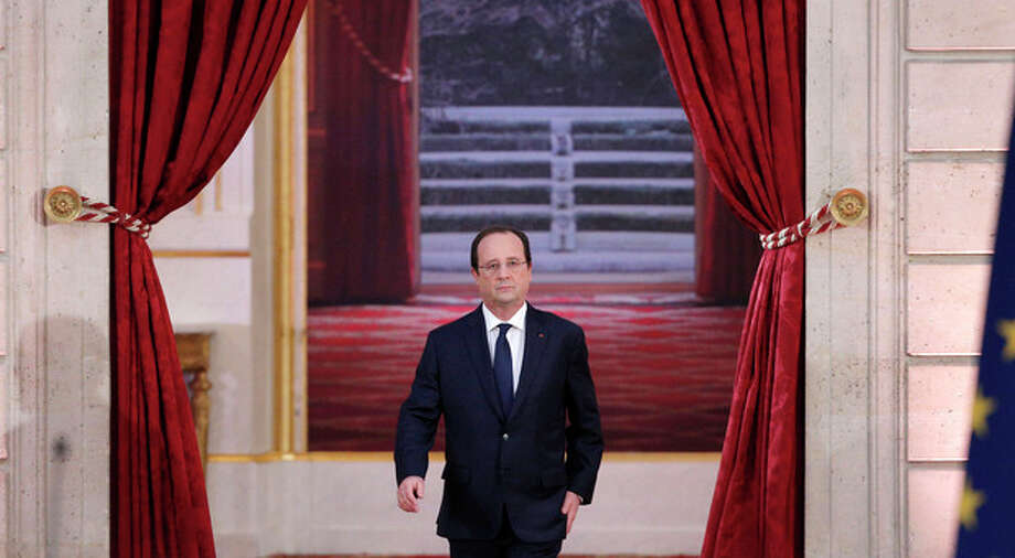 French President Francois Hollande arrives to deliver his speech at his annual news conference, Tuesday, Jan.14, 2014 at the Elysee Palace in Paris. The French president's complex personal life ó and what it means to be the first lady in modern society ó may get a full airing as Hollande answers questions for the first time since a tabloid reported he was having an affair with an actress. (AP Photo/Christophe Ena) / AP