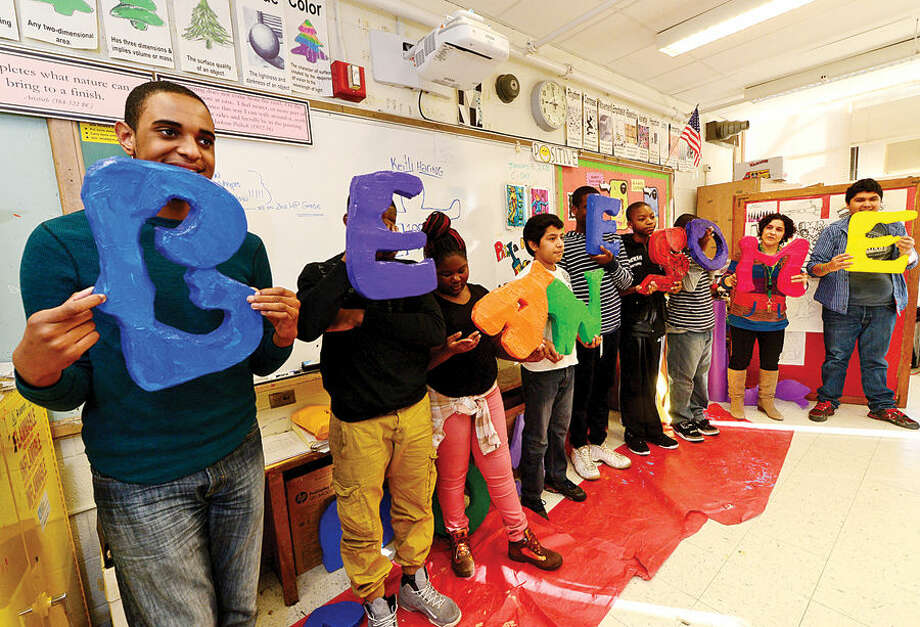 "Hour photo / Erik Trautmann West Rocks Middle School students in Melissa Fusarelli's art class make letters that spell out ""Be Awesome"" Thursday as part of the school's ""100 Days of No Violence"" agreement where the students pledge to live peacefully over the next 100 days."