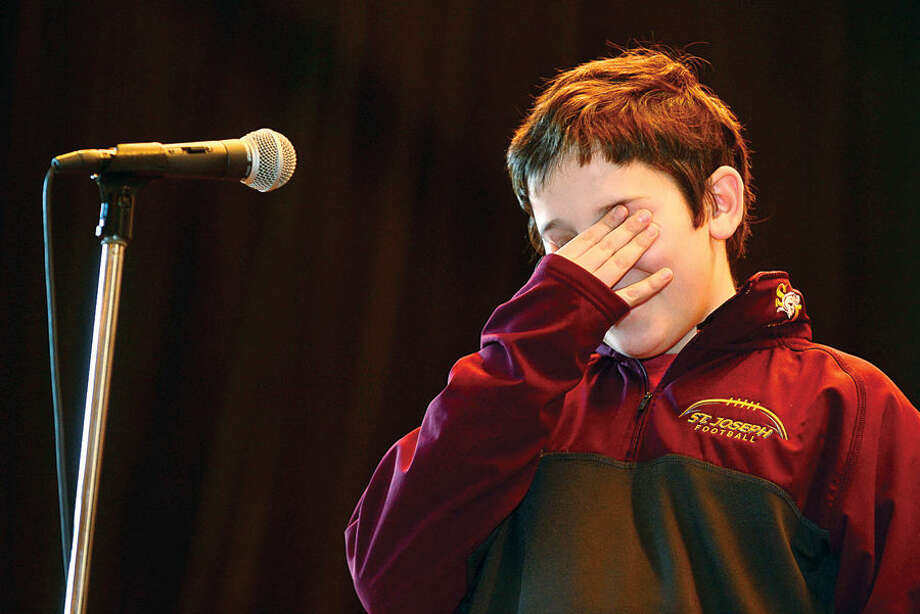 Hour photo / Erik Trautmann Nathan Hale Middle School 8th grader Nick DiIorio is stumped during the school's The National Geographic Geography Bee competition Thursday involving 24 students in grades 6, 7 and 8. The winner of the competition will go on to compete at the state level.