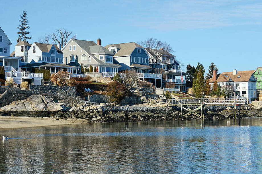 Hour photo / Erik Trautmann Connecticut Department of Energy and Environmental Protection will hold a public hearing on the proposed dredging/dock construction at 5 Cliff Place on Bell Island in Rowayton. Over 60 residents signed a petition against the plan.