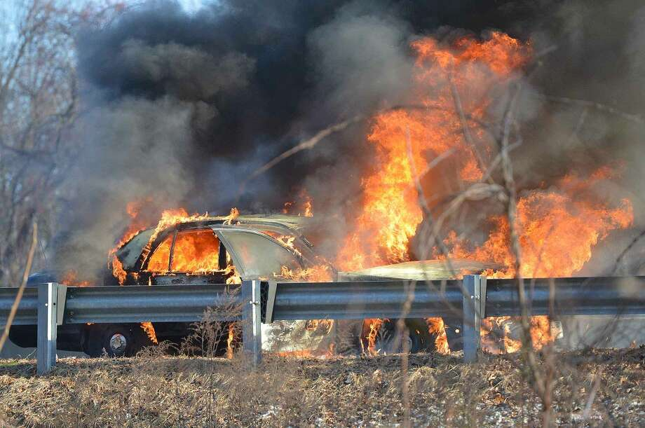 Hour Photo/Alex von KleydorffA taxi burns on the soutbound side of I 95 at approx 3:30 pm on Thursday