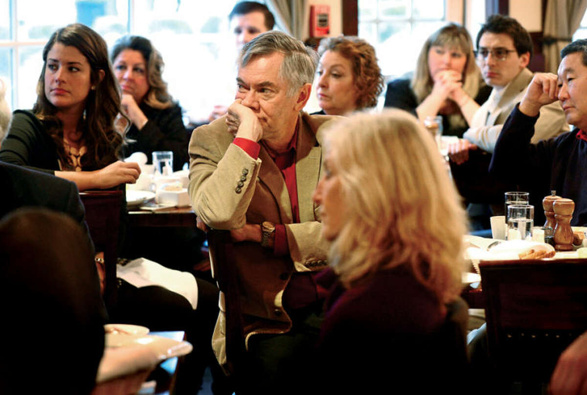 """Hour photo / Erik Trautmann Chamber members listen to Dr. Nicholas Perna, Chief Economist of Webster Bank and this year's keynote speaker, at The Wilton Chamber of Commerce's """"Economic Forecast Breakfast"""" Tuesday at Marly's Bistro."""