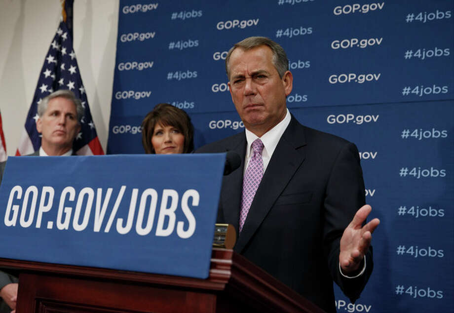 House Speaker John Boehner of Ohio, and GOP leaders face reporters on Capitol Hill in Washington, Tuesday, Jan. 14, 2014, following a weekly House Republican Conference meeting. Behind Boehner are, from left, House Majority Whip Kevin McCarthy of Calif., and Rep. Kristi Noem, R-S.D. The Republicans tied the recent stagnant employment reports to the policies of President Barack Obama and Democratic lawmakers. (AP Photo/J. Scott Applewhite) / AP