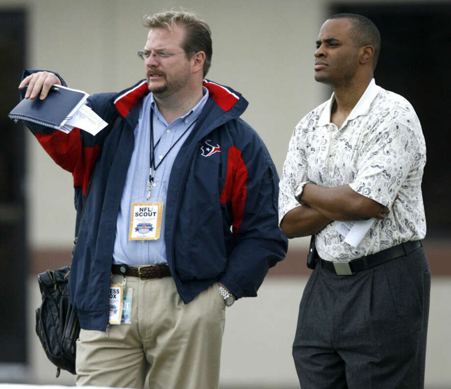 FILE - In this Jan. 13, 2007, file photo, Mike Maccagnan, left, coordinator of college scouting for the Houston Texans, talks to Texans general manager Rick Smith as they watch the North-South All-Star Classic college football game in Houston. The Jets hired former Texans executive Maccagnan as general manager on Tuesday, Jan. 13, 2015, replacing the fired John Idzik. Maccagnan was the only GM candidate who received a second meeting with the Jets. (AP Photo/Houston Chronicle, Brett Coomer, File)