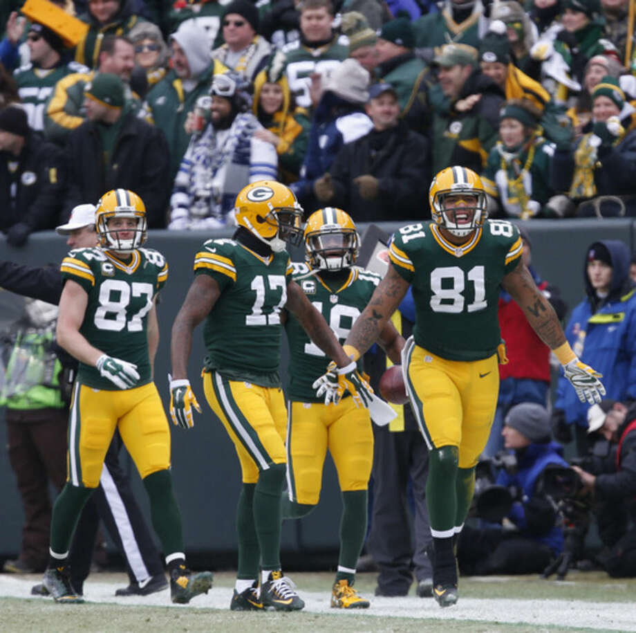 Green Bay Packers tight end Andrew Quarless (81) celebrates a touchdown during the first half of an NFL divisional playoff football game against the Dallas Cowboys Sunday, Jan. 11, 2015, in Green Bay, Wis. (AP Photo/Mike Roemer)