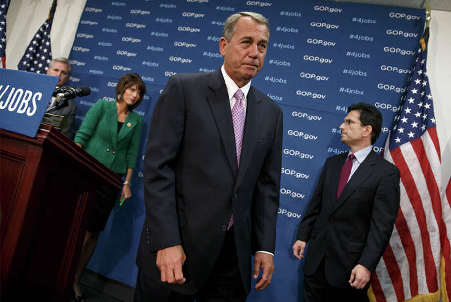 House Speaker John Boehner of Ohio and GOP leaders finish a news conference on Capitol Hill in Washington, Tuesday, Jan. 14, 2014, following a weekly House Republican Conference meeting. From left are, House Majority Whip Kevin McCarthy of Calif., Rep. Kristi Noem, R-S.D., and House Majority Leader Eric Cantor of Va. The Republicans tied the recent stagnant employment reports to the policies of President Barack Obama and Democratic lawmakers. (AP Photo/J. Scott Applewhite) / AP