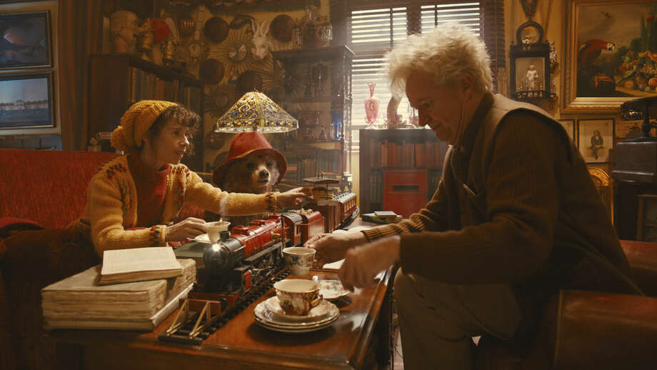 "This image released by The Weinstein Company shows Sally Hawkins, left, and Jim Broadbent in a scene from ""Paddington."" (AP Photo/The Weinstein Company)"