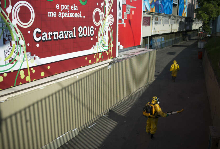 A health worker sprays insecticide to combat the Aedes aegypti mosquitoes that transmits the Zika virus under the bleachers of the Sambadrome in Rio de Janeiro, Brazil, Tuesday, Jan. 26, 2016. Inspectors begin to spray insecticide around Sambadrome, the outdoor grounds where thousands of dancers and musicians will parade during the city's Feb. 5-10 Carnival celebrations. Brazil's health minister says the country will mobilize some 220,000 troops to battle the mosquito blamed for spreading a virus linked to birth defects. (AP Photo/Leo Correa)