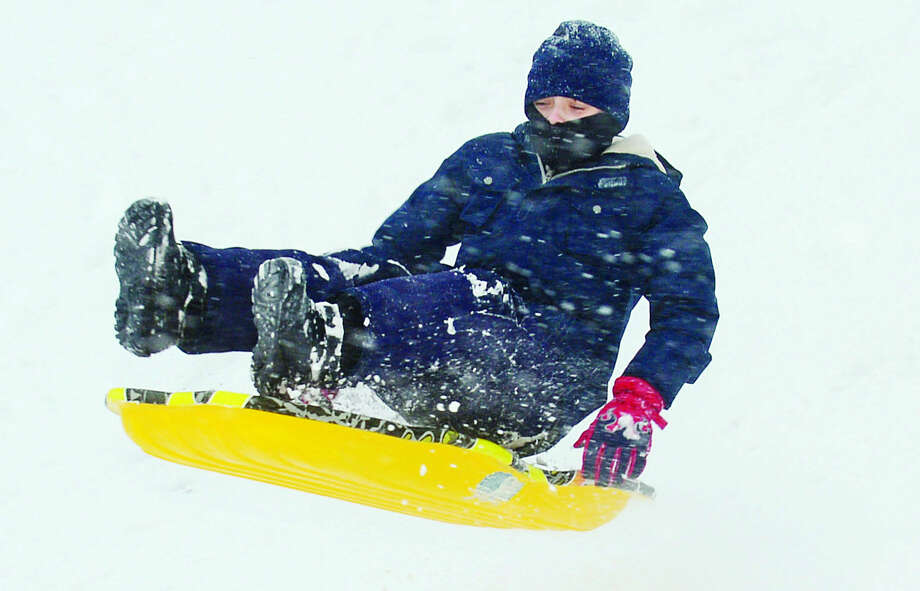 Hour photo / Erik Trautmann 10-year-old Trevor Boles sleds at Wolfpit Elementary School Snowstorm Jonas on Saturday afternoon.
