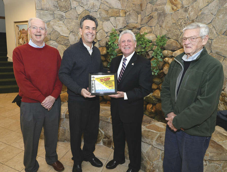 Hour photo/Alex von KleydorffSt. Ann Club President Sal Fratino accepts a Top Lighthouse rating award from Mayor Harry Rilling and the Norwalk Health Department's Director Timothy Callahan, far left, and member Dr. Edward J. Tracey, far right.