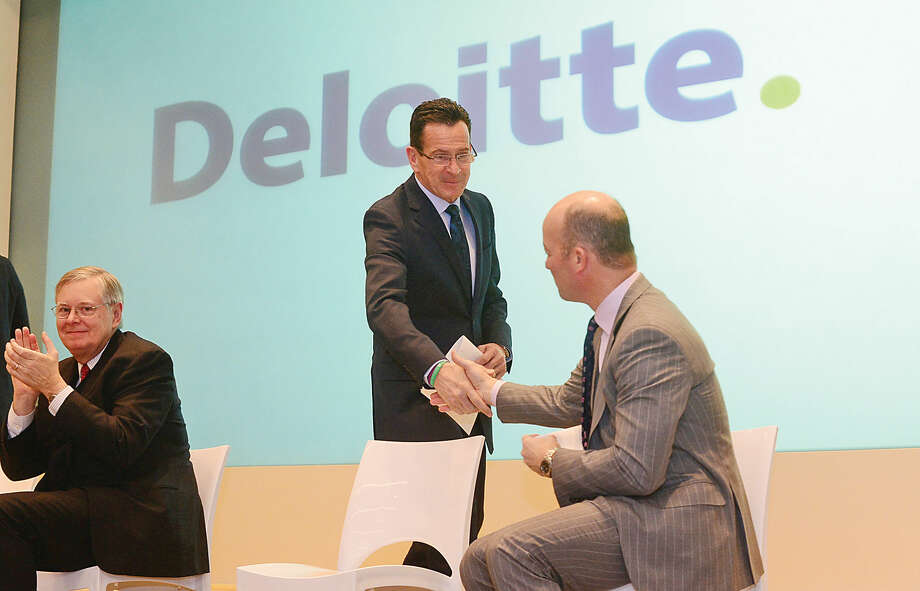 From left to right:Building and Land Technology CEO Carl Kuehner, Deloitte partner Kevin Richards, Mayor David Martin, Gov. Dannel P. Malloy, and Deloitte managing partner Steve Gallucci, cut the ribbon at Deloitte's new headquarters at the BLT Financial Centre on East Main Street in Stamford Tuesday.