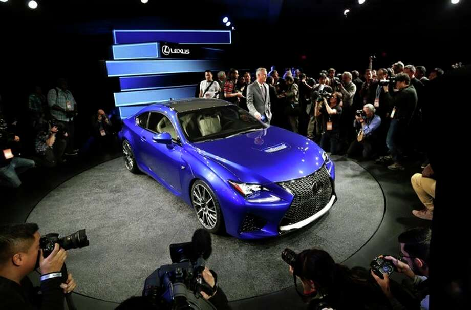 Lexus Group Vice President and General Manager Jeff Bracken reveals the new Lexus RC F Coupe at the North American International Auto Show in Detroit, Tuesday, Jan. 14, 2014. (AP Photo/Carlos Osorio) / AP