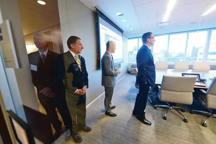 From left to right: Building and Land Technology CEO Carl Kuehner, Deloitte partner Kevin Richards, Mayor David Martin, Gov. Dannel P. Malloy, and Deloitte managing partner Steve Gallucci, cut the ribbon at Deloitte's new headquarters at the BLT Financial Centre on East Main Street in Stamford Tuesday.