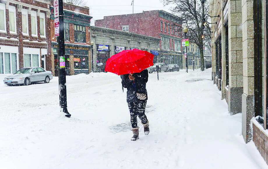 Hour photo / Erik Trautmann Norwalkers like Francesca Esor resists the elements during Snowstorm Jonas on Saturday afternoon.
