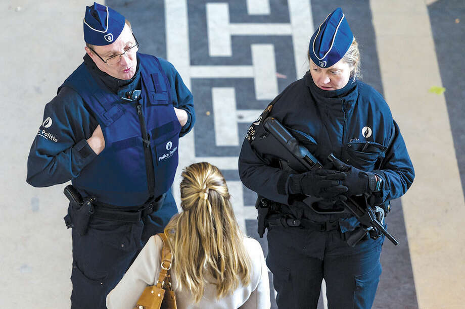 Police guard the Palace of Justice in Brussels, Friday, Jan. 16, 2015. Thirteen people were detained in Belgium and two arrested in France in an anti-terror sweep following a firefight in which two suspected terrorists were killed in the eastern city of Verviers on Thursday. (AP Photo/Geert Vanden Wijngaert)