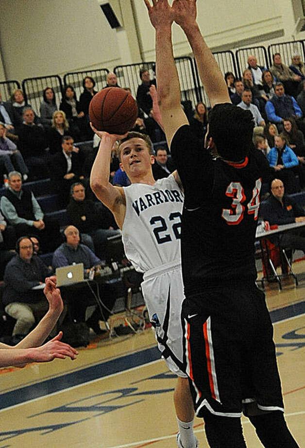 Wilton #22 Drew Connolly vs. Ridgefield on Tuesday at Wilton. Hour photo/Matthew Vinci