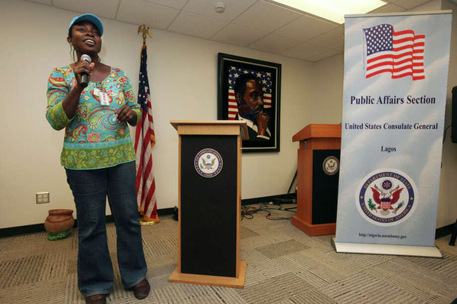 FILE - In this, Friday, Dec. 2, 2011 photo, Abosede Oladayo, 36, an AIDS activist living with HIV, speaks during an event to mark World Aids Day at the U.S Embassy in Lagos, Nigeria. Local and international groups fighting AIDS warned on Tuesday, Jan. 14, 2014, that a new Nigerian law criminalizing same-sex marriage and gay organizations will jeopardize the fight against the deadly disease. The United States, Britain and Canada condemned the law, with Secretary of State John Kerry saying Monday that it 'dangerously restricts freedom' of expression and association of all Nigerians.(AP Photo/Sunday Alamba, File) / AP