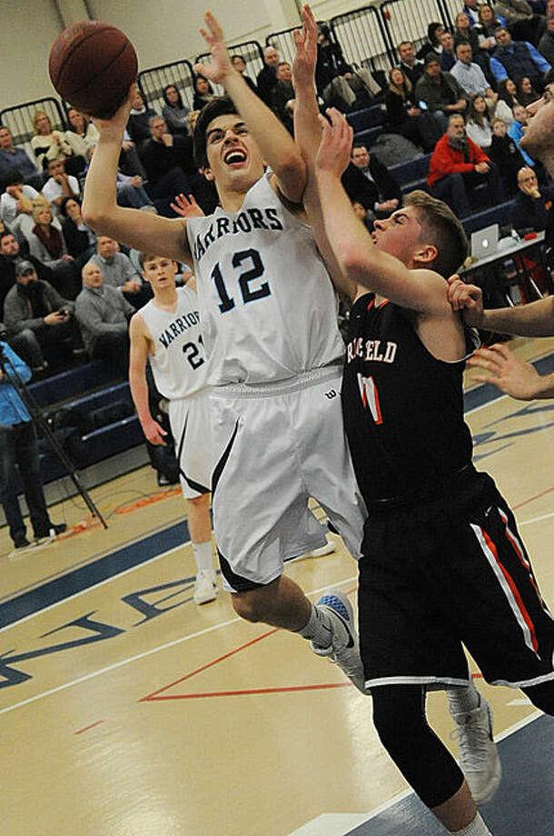 Wilton Kyle Shifrin vs. Ridgefield on Tuesday at Wilton. Hour photo/Matthew Vinci