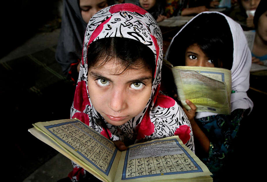 Pakistani girls read the Quran, Islam's holy book, at a local madrassa or seminary in Karachi, Pakistan, Wednesday, Jan. 27, 2016. (AP Photo/Fareed Khan)